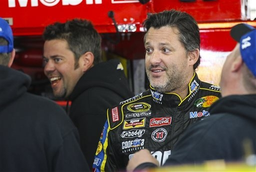 Driver Tony Stewart enjoys a light moment in his garage with crew members before practice for Sunday's NASCAR Sprint Cup auto race at New Hampshire Motor Speedway, Friday, Sept. 19, 2014, in Loudo ...