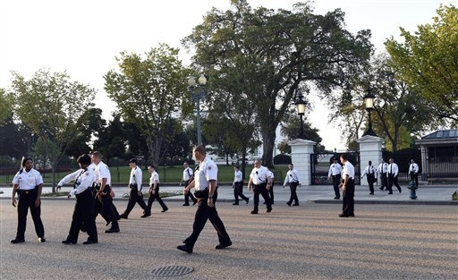 Uniformed Secret Service officers walk along Pennsylvania Avenue in front of the White House and head to Lafayette Park in Washington, Saturday, Sept. 20, 2014.   The Secret Service is coming unde ...