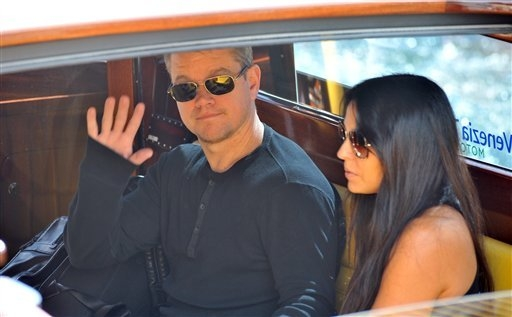 Matt Damon, left and his wife Luciana Barroso, arrive at Venice Lido, Italy,  Friday, Sept. 26, 2014. Actor director George Clooney revealed earlier this month at a star-studded benefit in Florenc ...