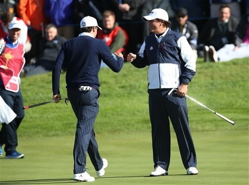 Keegan Bradley, left, and Phil Mickelson, right, of the U.S. celebrate winning the 10th hole during the fourball match on the first day of the Ryder Cup golf tournament, at Gleneagles, Scotland, F ...