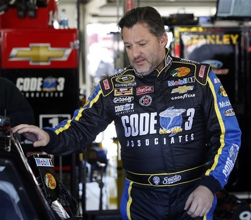 Driver Tony Stewart gets ready for practice for Sunday's NASCAR Sprint Cup Series auto race at New Hampshire Motor Speedway, Friday, Sept. 19, 2014, in Loudon, N.H. (AP Photo/Jim Cole)