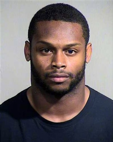 This Sept. 17, 2014 booking photo provided by the Maricopa County, Ariz., Sheriff's Office shows Arizona Cardinals running back Jonathan Dwyer. Arizona Cardinals running back Jonathan Dwyer was ar ...