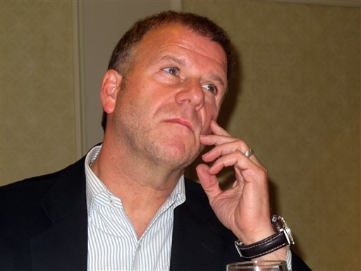 In this Aug. 31, 2012 photo Golden Nugget owner Tilman Fertitta listens at a news conference to discuss a lawsuit over games of mini-baccarat at the casino in April 2012 at which players won $1.5  ...