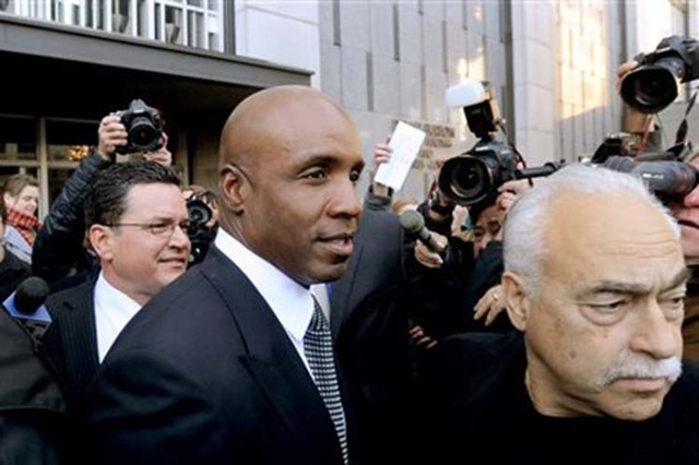 In this Dec. 16, 2011 file photo, former baseball player Barry Bonds leaves federal court after being sentenced for obstructing justice in a government steroids investigation in San Francisco. Nea ...