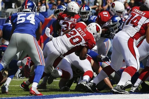 Arizona Cardinals running back Jonathan Dwyer (20) rushes for a touchdown during the first half of an NFL football game against the New York Giants, Sunday, Sept. 14, 2014, in East Rutherford, N.J ...
