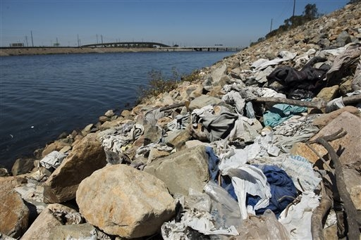 FILE-This Tuesday, Sept. 2, 2014 file photo shows a large pile of washed-up trash, including old plastic bags, sits alongside the Los Angeles River in Long Beach, Calif. On Tuesday, Sept. 30, 2014 ...