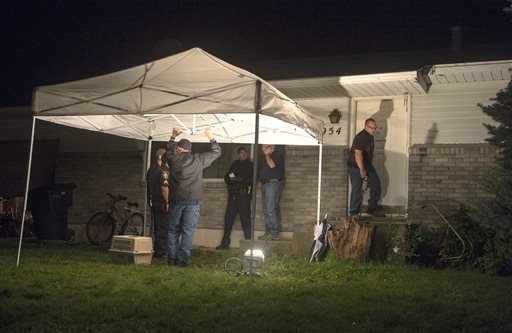Springville Police investigate the scene where where a family of five -- Benjamin Strack, 37, his wife, Kristi, 36, and three of their children, Benson, 14, Emery, 12, and Zion, 11 --  were found  ...