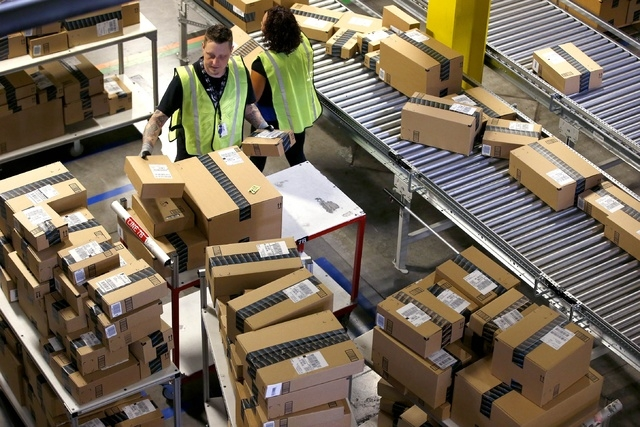 Amazon.com employees organize outbound packages at an Amazon.com Fulfillment Center. (AP Photo/Ross D. Franklin)