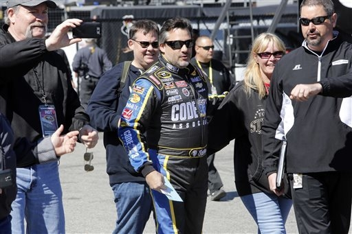 Driver Tony Stewart arrives for practice for Sunday's NASCAR Sprint Cup Series auto race at New Hampshire Motor Speedway Friday, Sept. 19, 2014, in Loudon, N.H. (AP Photo/Jim Cole)