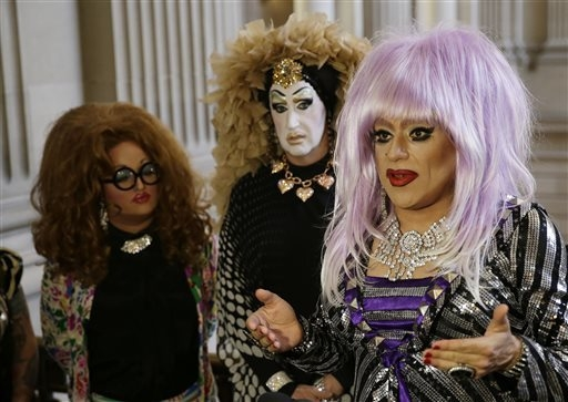 Drag queens from left, Lil Ms. Hot Mess, Sister Roma and Heklina take turns speaking about their battle with Facebook during a news conference at City Hall Wednesday, Sept. 17, 2014, in San Franci ...