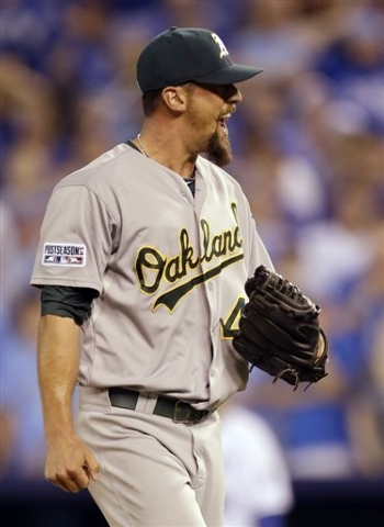 Oakland Athletics relief pitcher Luke Gregerson celebrates after striking out Kansas City Royals' Omar Infante to end the eighth inning of the AL wild-card playoff baseball game Tuesday, Sept. 30, ...
