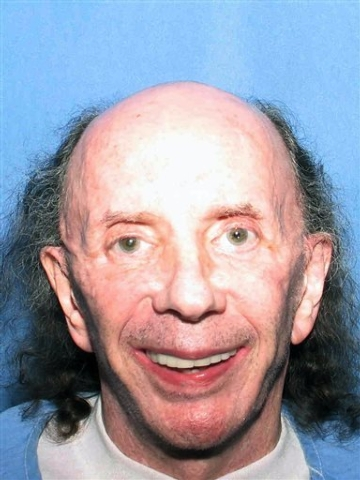This July 24, 2013 photo released by the California Department of Corrections and Rehabilitation shows a photo of former music producer Phil Spector  smiling at the camera at the California Substa ...