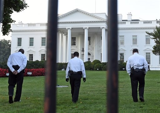 Uniformed Secret Service officers walk along the lawn on the North side of the White House in Washington, Saturday, Sept. 20, 2014. The Secret Service is coming under renewed scrutiny after a man  ...
