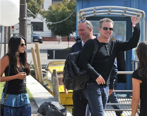 Matt Damon, right, and his wife Luciana Barroso, left, arrive at Venice Lido, Italy,  Friday, Sept. 26, 2014. Actor director George Clooney revealed earlier this month at a star-studded benefit in ...
