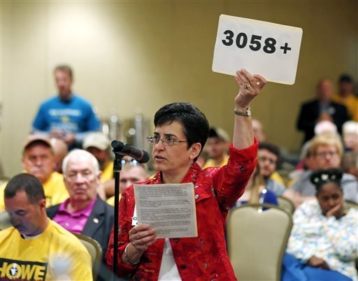 Mary Beth Earley of East Greenbush, N.Y., speaks against a casino in her town during a public meeting on casinos on Monday, Sept. 22, 2014, in Albany, N.Y. Supporters and critics of proposals for  ...