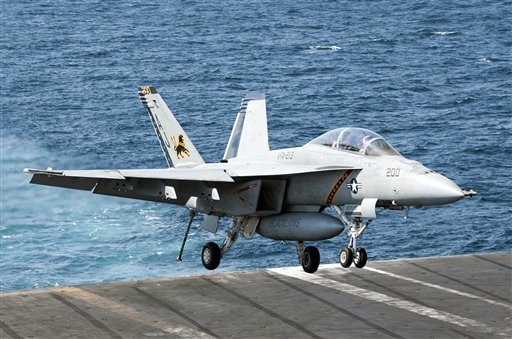 In this image provided by the U.S. Navy a F/A-18F Super Hornet attached to the Fighting Black Lions of Strike Fighter Squadron lands aboard the aircraft carrier USS George H.W. Bush in the Persian ...