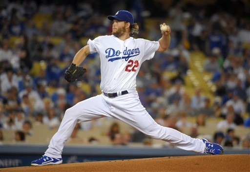 Los Angeles Dodgers starting pitcher Clayton Kershaw throws to the plate during the first inning of a baseball game against the San Francisco Giants, Wednesday, Sept. 24, 2014, in Los Angeles. (AP ...