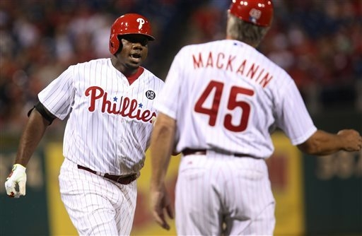 Philadelphia Phillies' Ryan Howard is congratulated by third base coach Pete Mackanin after hitting a home run in the second inning of a baseball game against the Atlanta Braves, Saturday, Sept. 2 ...