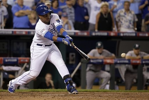 Kansas City Royals' Salvador Perez hits a walk-off single to drive in Christian Colon with the winning run in the 12th inning, giving the Royals a 9-8 win over the Oakland Athletics in the AL wild ...