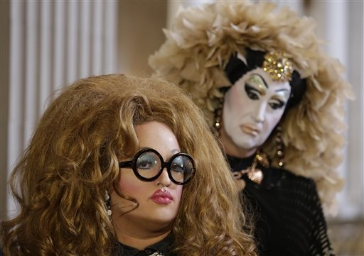 Drag queens Lil Ms. Hot Mess, left, and Sister Roma, right, listen to comments about their battle with Facebook during a news conference at City Hall Wednesday, Sept. 17, 2014, in San Francisco, C ...