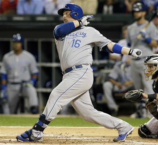Kansas City Royals' Billy Butler hits an RBI single against the Chicago White Sox during the first inning of a baseball game in Chicago on Friday, Sept. 26, 2014. (AP Photo/Nam Y. Huh)