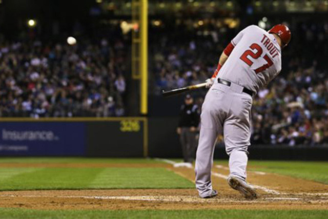 Los Angeles Angels' Mike Trout hits a home run in the sixth inning of a baseball game against the Seattle Mariners, Friday, Sept. 26, 2014, in Seattle. (AP Photo/Ted S. Warren)