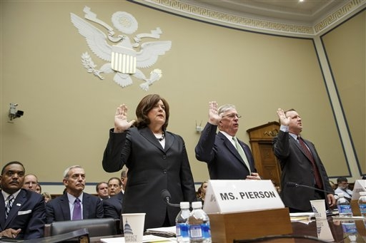 Secret Service Director Julia Pierson, left, is sworn in on Capitol Hill in Washington, Tuesday, Sept, 30, 2014, prior to testifying before the House Oversight Committee as it examines details sur ...