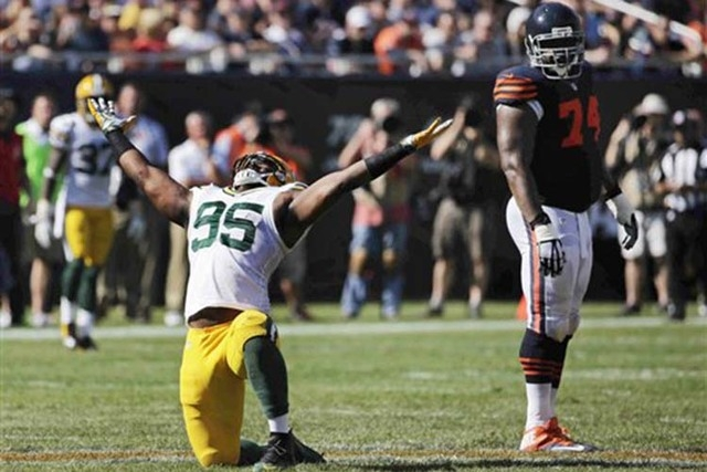 Green Bay Packers defensive end Datone Jones (95) celebrates after sacking Chicago Bears quarterback Jay Cutler in the second half of an NFL football game Sunday, Sept. 28, 2014, in Chicago. At ri ...