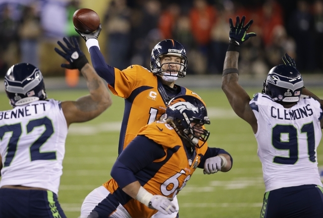 Denver Broncos' Peyton Manning throws against the Seattle Seahawks during the second half of the NFL Super Bowl XLVIII football game Sunday, Feb. 2, 2014, in East Rutherford, N.J. (AP Photo/Chris  ...
