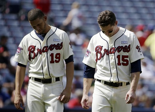 Atlanta Braves' Phil Gosselin, right, walks on the field with teammate Andrelton Simmons after Gosselin struck out with the bases loaded in the fifth inning of a baseball game against the New York ...