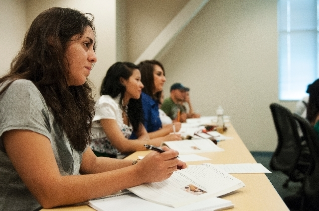 ESL students take notes during an intermediate English learning class at the Charleston campus of the College of Southern Nevada. (Review-Journal File)
