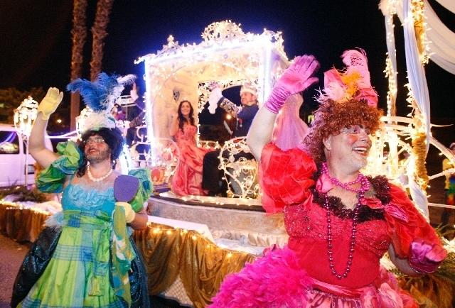 Scott Nelson, left, and Jim McCoy of MGM Resorts Events wave during the annual Pride Parade on Fourth Street in downtown Las Vegas, Sept. 7, 2012. This year's parade is scheduled for
