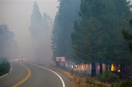Fire creeps through tall trees near Uncle Tom's Cabin in El Dorado County on Thursday, Sept. 18, 2014. The King fire has burned over 70,000 acres. The wind-whipped fire burned through 114 square m ...