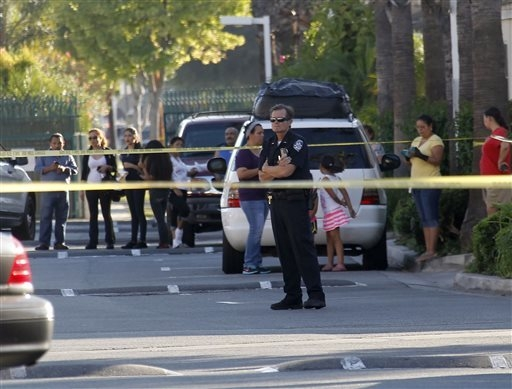 A police officer stands by the scene of a shooting in Bell Gardens, Calif., Tuesday, Sept. 30, 2014. Authorities say Mayor Daniel Crespo, of the Los Angeles suburb of Bell Gardens, has been shot t ...