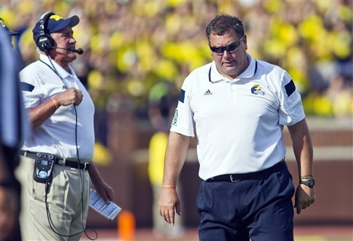 Michigan head coach Brady Hoke, right, reacts on the sideline next to defensive coordinator Greg Mattison, left, in the second quarter of an NCAA college football game against Minnesota in Ann Arb ...
