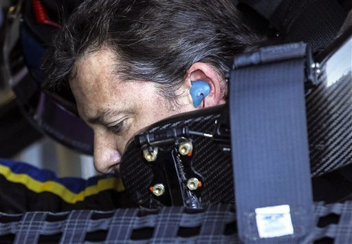 Driver Tony Stewart sits in his car gets as it gets serviced during practice for the NASCAR Sprint Cup auto race at New Hampshire Motor Speedway, Friday, Sept. 19, 2014, in Loudon, N.H. (AP Photo/ ...