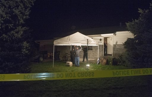 Springville Police investigate the scene where five family members were found dead in a home in Springville, Utah, on Saturday, Sept. 27, 2014. (AP Photo/The Salt Lake Tribune, Rick Egan)