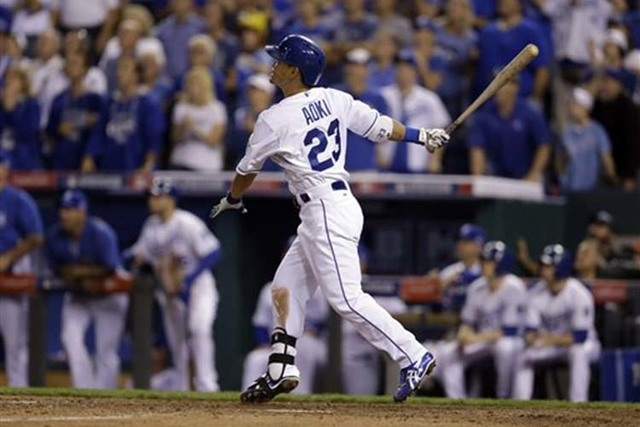 Kansas City Royals' Norichika Aoki watches his sacrifice fly scoring that scored Jarrod Dyson to tie the AL wild-card playoff baseball game against the Oakland Athletics during the ninth inning, T ...