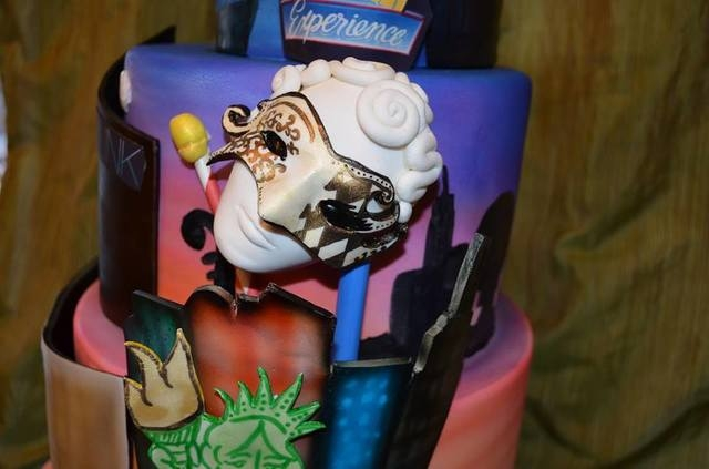 A birthday cake created by Michelle Curran, better known as Chef Mitchie, is displayed at an event last year. The chef volunteers with Icing Smiles, a nonprofit that provides cakes for children wh ...