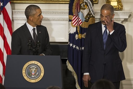 President Barack Obama, accompanied by Attorney General Eric Holder, speaks in the State Dining Room of the White House in Washington, Thursday, Sept. 25, 2014, to announce Holder is resigning. Ho ...