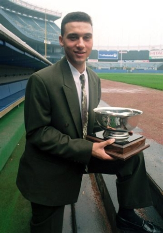 FILE - In this Sept. 14, 1994 file photo, New York Yankees shortstop prospect Derek Jeter poses on the dugout steps at Yankee Stadium in New York after he was named Baseball America's minor league ...