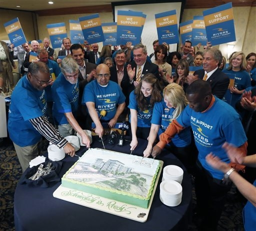 Supporters of the proposed Rivers Casino and Resort at Mohawk Harbor in Schenectady, N.Y., cut a cake during a news conference as a public meeting on casinos was being held in a nearby conference  ...