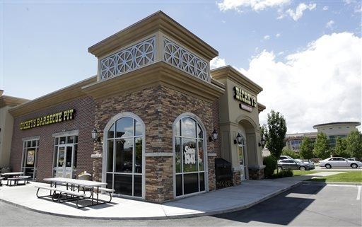 This Aug. 14, 2014, file photo, shows the exterior of Dickey's Barbecue Pit in South Jordan, Utah. No charges will be filed in a case involving a woman who nearly died after unknowingly drinking i ...