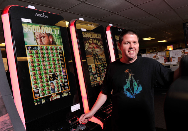 """Arisocrat's Ryan Hawkins, director of game design, explains some of the features of the upcoming slot machine, """"Son of Anarchy,"""" at his Las Vegas office on Tuesday, Sept. 23, 2014. (David Becker/L ..."""