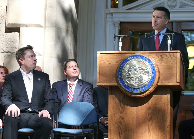 Nevada Gov. Brian Sandoval announces that Nevada was chosen as the new site for a $5 billion Tesla Motors car battery factory, during a press conference at the Capitol in Carson City, Nev., on Thu ...