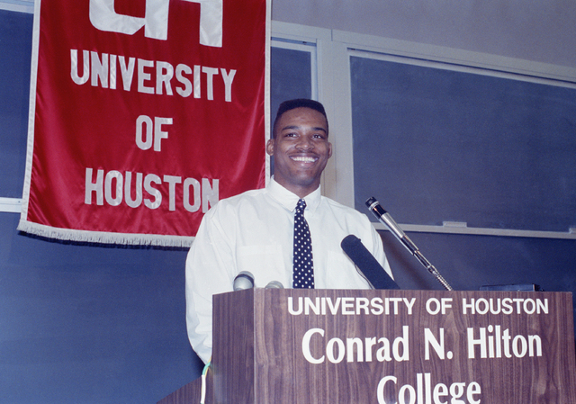 University of Houston quarterback and Heisman trophy winner Andre Ware is all smiles after he announced that he would forego his senior year at the university and turn professional, March 16, 1990 ...