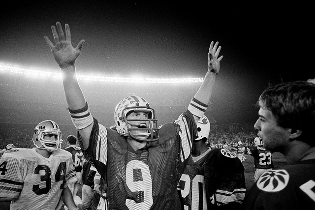 Brigham Young University quarterback Jim McMahon raises his arms in celebration as BYU defeated Washington State 38-36 in the Holiday Bowl in San Diego, Dec. 19, 1981. McMahon was named Most Valua ...