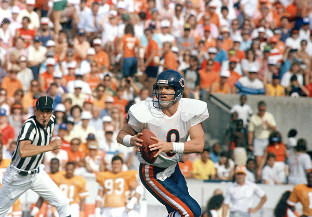 Chicago Bears quarterback Jim McMahon (9) steps up into the pocket and unloads his first pass from the scrimmage during the game between the Bears and Tampa Bay Buccaneers in Tampa on Oct. 25, 198 ...