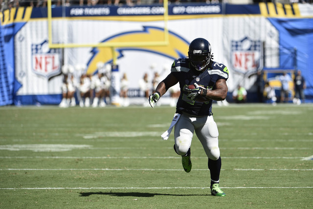 Seattle Seahawks running back Marshawn Lynch scores against the San Diego Chargers during the second half of an NFL football game on Sunday, Sept. 14, 2014, in San Diego. (AP Photo/Denis Poroy)