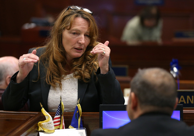 Nevada Assembly Speaker Marilyn Kirkpatrick, D-North Las Vegas, talks with Assemblyman Paul Anderson, R-Las Vegas, at the Legislature in Carson City, Nev., on Wednesday, Sept. 10, 2014. Nevada Gov ...